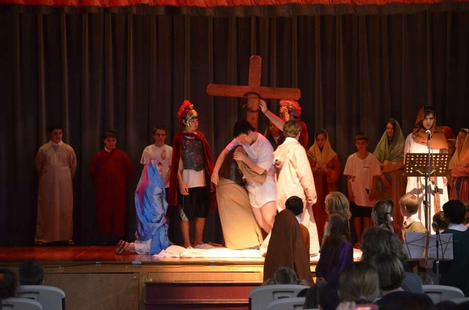 Kate Hartman/Register Citizen. St. Peter/St. Francis students performed the Stations of the Cross for classmates and parents.
