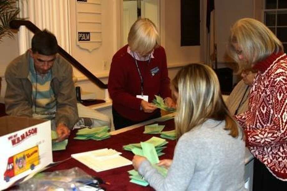 Votes being counted at the meeting Tuesday. Photo by Kathryn Boughton/The Litchfield County Times.