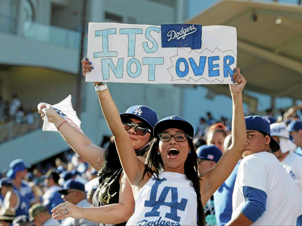 Dodgers fans cheer after Game 5 of the National League baseball championship series against the St. Louis Cardinals. The Dodgers won 6-4 and trail in the series 3-2.