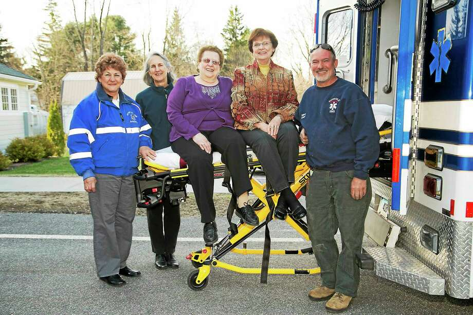 (left to right) Captain Sandy Evans; President Daryl Eaton; RoseMary Surdam, awards chair for the Auxiliary for Community Health;Milly Hudak, President of the Auxiliary for Community Health; and Chief Marc Tonan with the Stryker Power-LOAD equipment. Photo: Submitted Photo