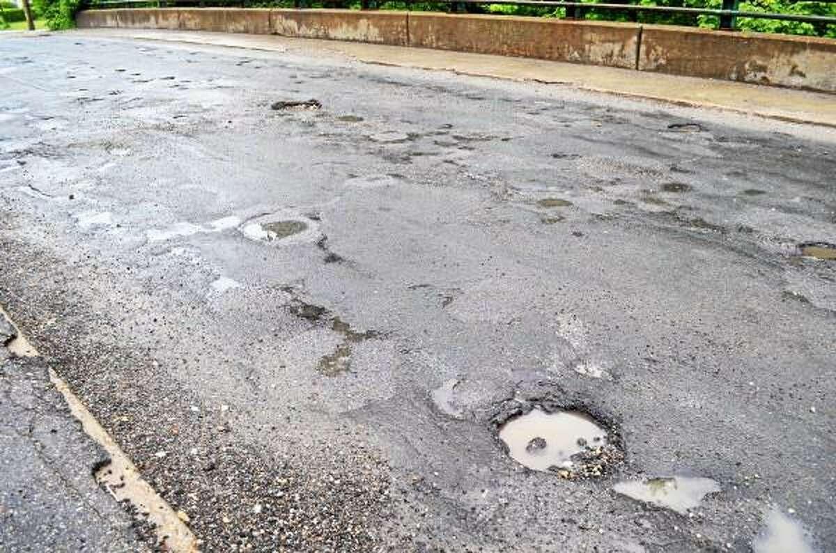 Potholes line Winsted's, Holabird Avenue bridge as seen on Thursday, June 13. (Tom Caprood-Register Citizen)