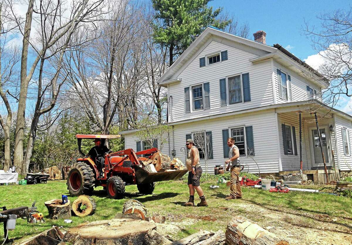 Volunteers work on 14 Camp Hill Rd. during the 27th annual HomeFront Day Saturday in Litchfield. More than 40 volunteers were on hand to help repair the home, as the program offers assistance to low-income families and some affected by Superstorm Sandy.