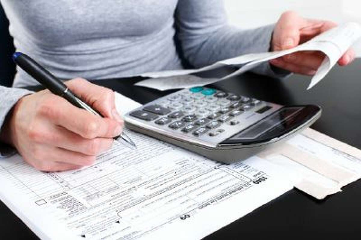 A woman works on her taxes.