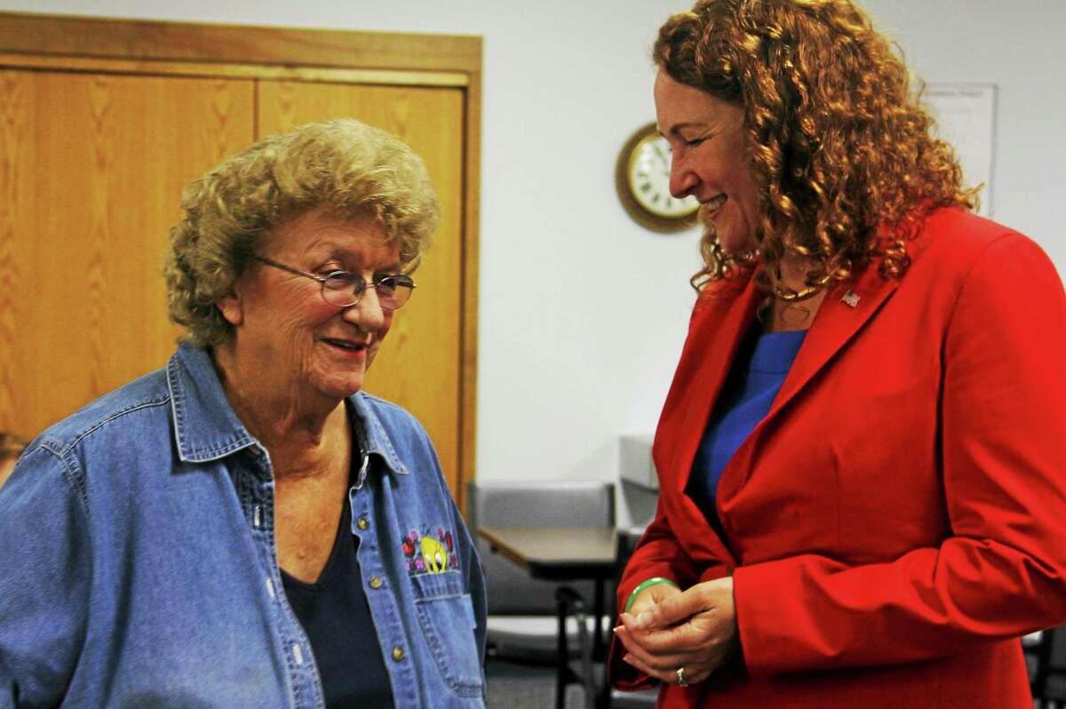 Dora Basso, of Torrington, meets U.S. Rep. Elizabeth Esty, D-5th, on Tuesday, Oct. 28, at the Sullivan Senior Center in Torrington. Esteban L. Hernandez Register Citizen