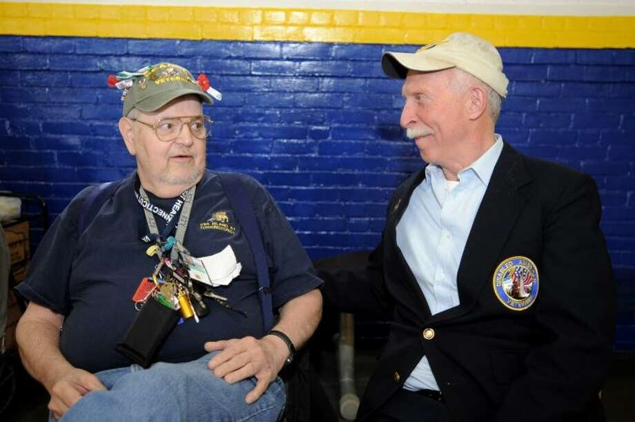 Laurie Gaboardi/Register Citizen -- Long time volunteer Jonathan Groas talks with DAV Commander David Opotzner.  Jonathan Groas is a Vietnam vet recipient of the Purple Heart, VFW Past Commander, DAV driver and is involved with the Boy Scouts from 1974 to present.