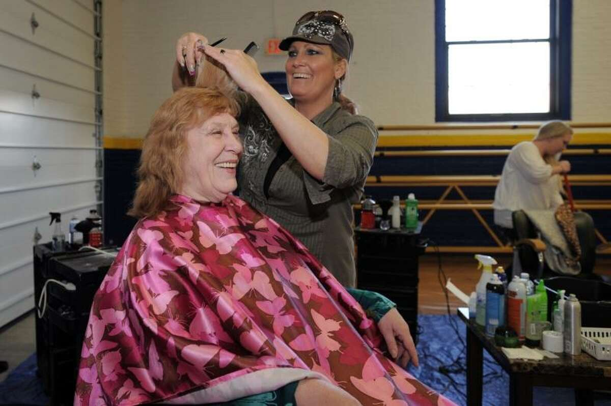 Laurie Gaboardi/Register Citizen -- Janet Kimball, an Army Vet from the Vietnam era. Her job was to brief and debrief soldiers on their way to Vietnam. She said that it was highly classified secretarial work involving encrypted information. She had her hair cut by Susan Gagnon from Hair Dr's in Torrington. Gagnon said that they gave 78 haircuts Wednesday.