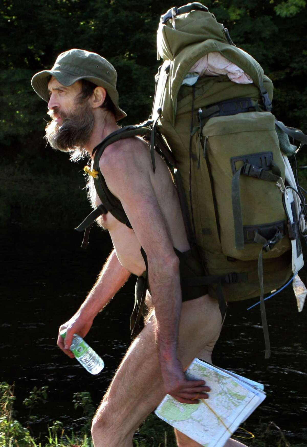 FILE - In this Monday, Oct. 2012 file photo, Stephen Gough, nicknamed the Naked Rambler, walks near Selkirk, Scotland. Gough, who spurns clothes lost a legal bid on Tuesday, Oct. 28, 2014 to have public nudity declared a human right. The European Court of Human Rights says Stephen Gough's rights were not violated by repeated arrests and convictions for being naked in public. (AP Photo/PA, David Cheskin, File)
