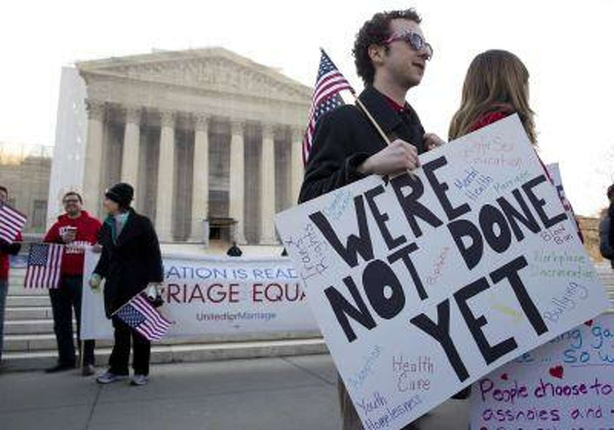 Supporters of gay marriage rally in front of the Supreme Court in Washington March 27, 2013.