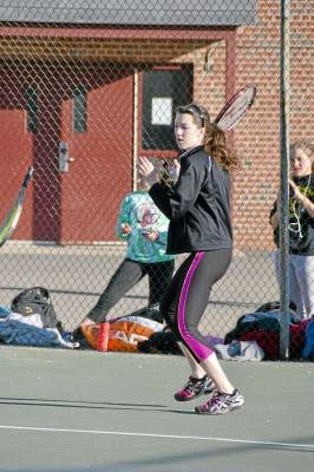 Pete Paguaga/Register Citizen Thomaston's Allison Snow, returning a serve during practice. She is slated to be the Golden Bears, number three in singles this season.