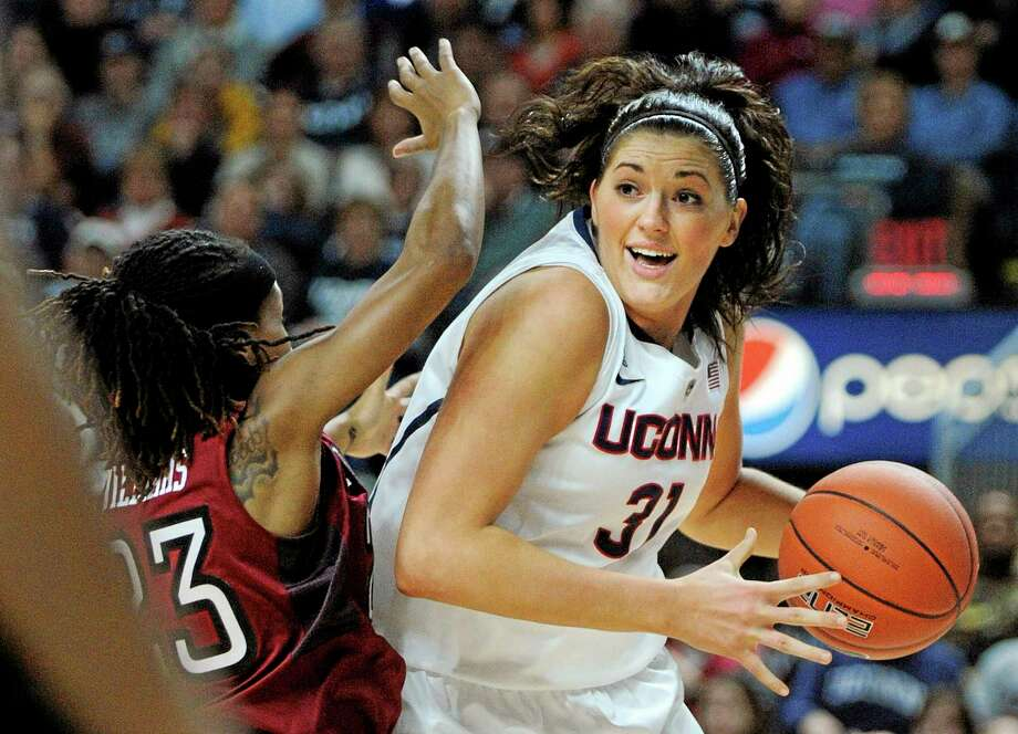 Connecticut's Stefanie Dolson (31) drives past Temple's Tyonna Williams (23) during the first half of an NCAA college basketball game in Bridgeport, Conn., Saturday, Jan. 11, 2014. (AP Photo/Fred Beckham) Photo: AP / FR153656 AP