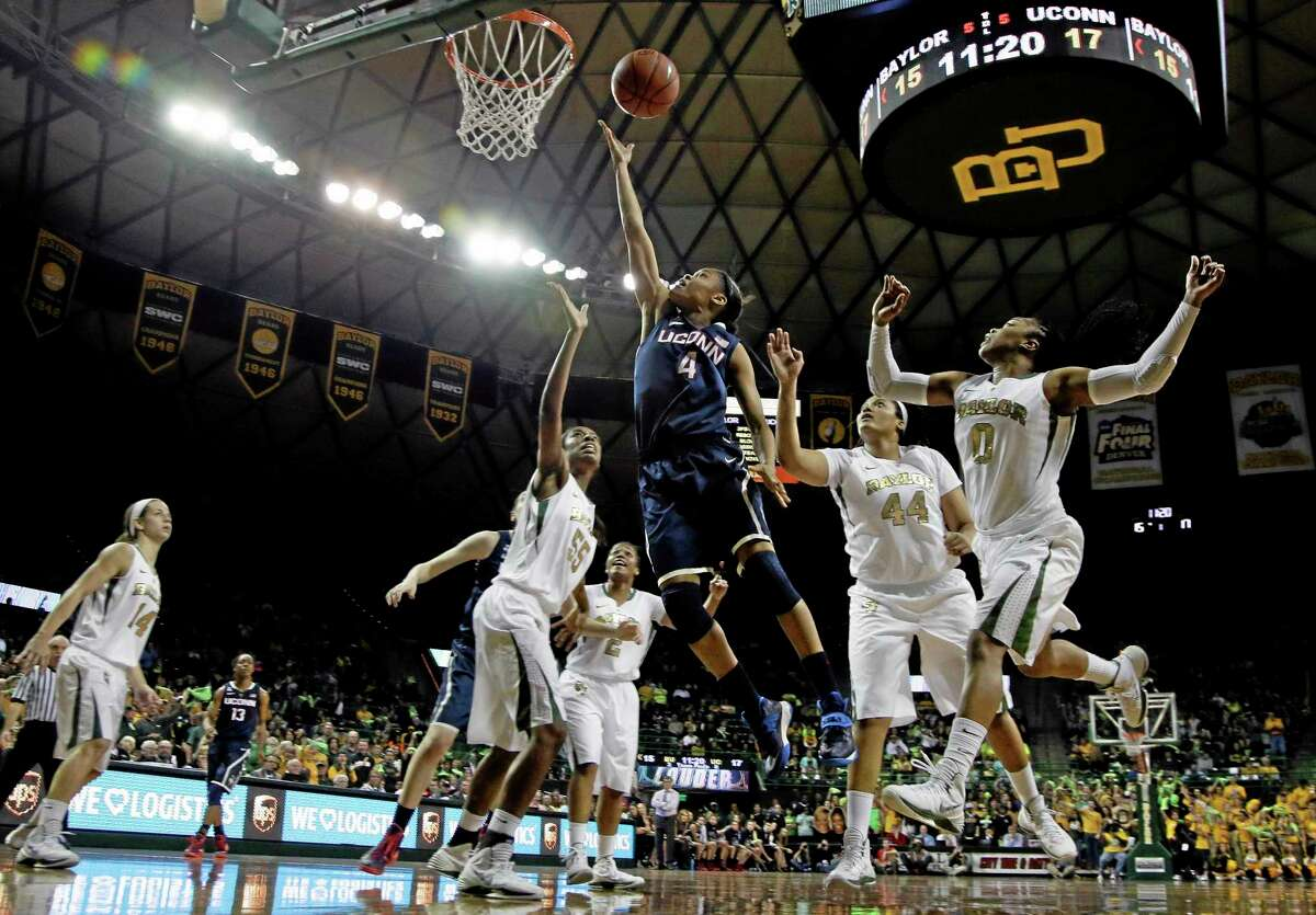 UConn's Moriah Jefferson (4) goes up for a shot surrounded by Baylor's Khadijiah Cave (55), Kristina Higgins (44) and Odyssey Sims (0) in the first half Monday.