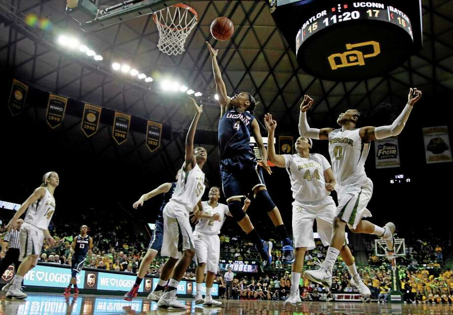 UConn's Moriah Jefferson (4) goes up for a shot surrounded by Baylor's Khadijiah Cave (55), Kristina Higgins (44) and Odyssey Sims (0) in the first half Monday. Photo: Tony Gutierrez — The Associated Press  / AP