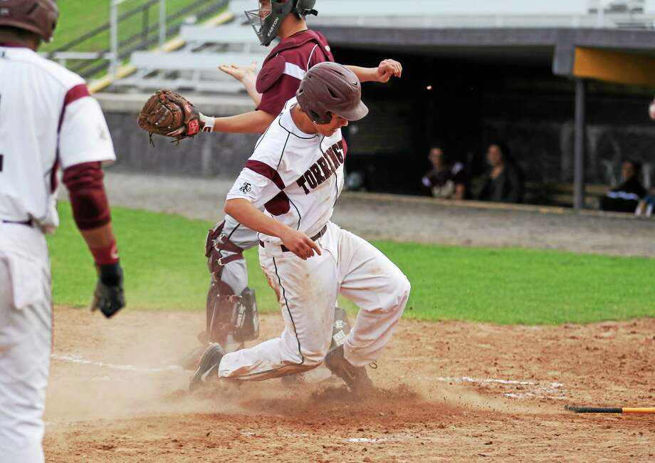 Torrington's Nate Manchester steals home during a game against Sacred Heart. The Red Raiders won 12-6. Photo: Marianne Killackey - Special To Register Citizen  / 2013