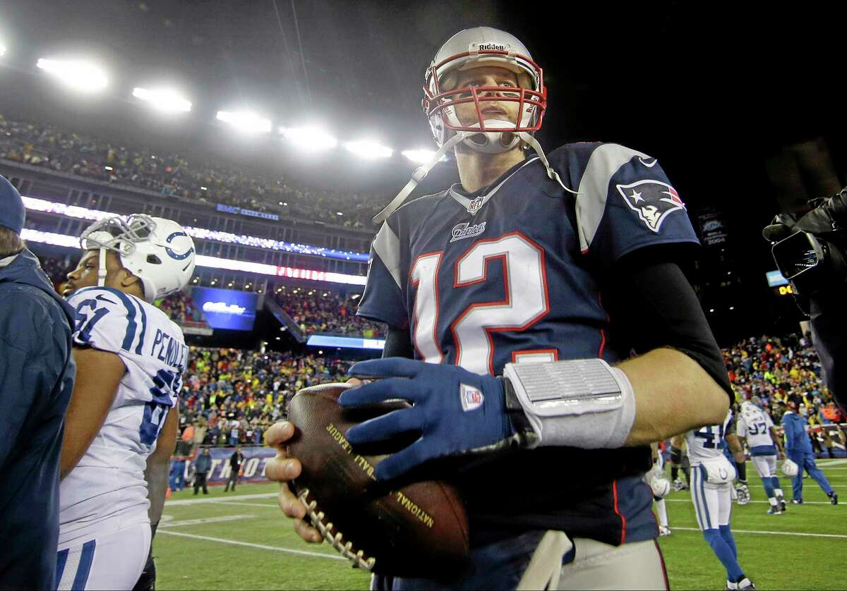 Patriots quarterback Tom Brady walks of the field after Sunday's win over the Colts.