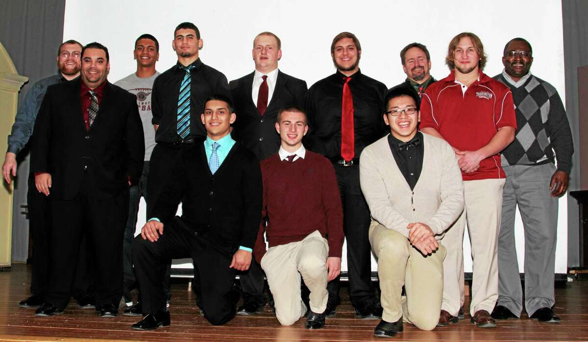 Torrington High School football seniors and coaches celebrated with the team at the school Monday night. They are, front row kneeling, left to right: Damian Lajoie, David Kisiel and Alex Rintharamy. Back row, left to right: Coach Andy Therriault, Head Coach Gaitain Rodriguez, Matt Hoxie, Desmond Langs, Ernie Tracy, Joe Kenney, Coach Brian Becker, Coach Mark Mangelinkx, Coach Ollie Gray.