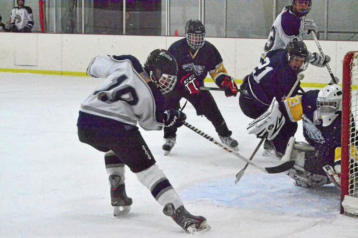 Shepaug-Litchfield-Nonnewaug's Griffin Smith scores a goal in the Spartans 8-3 win over Mount Everett (MA).