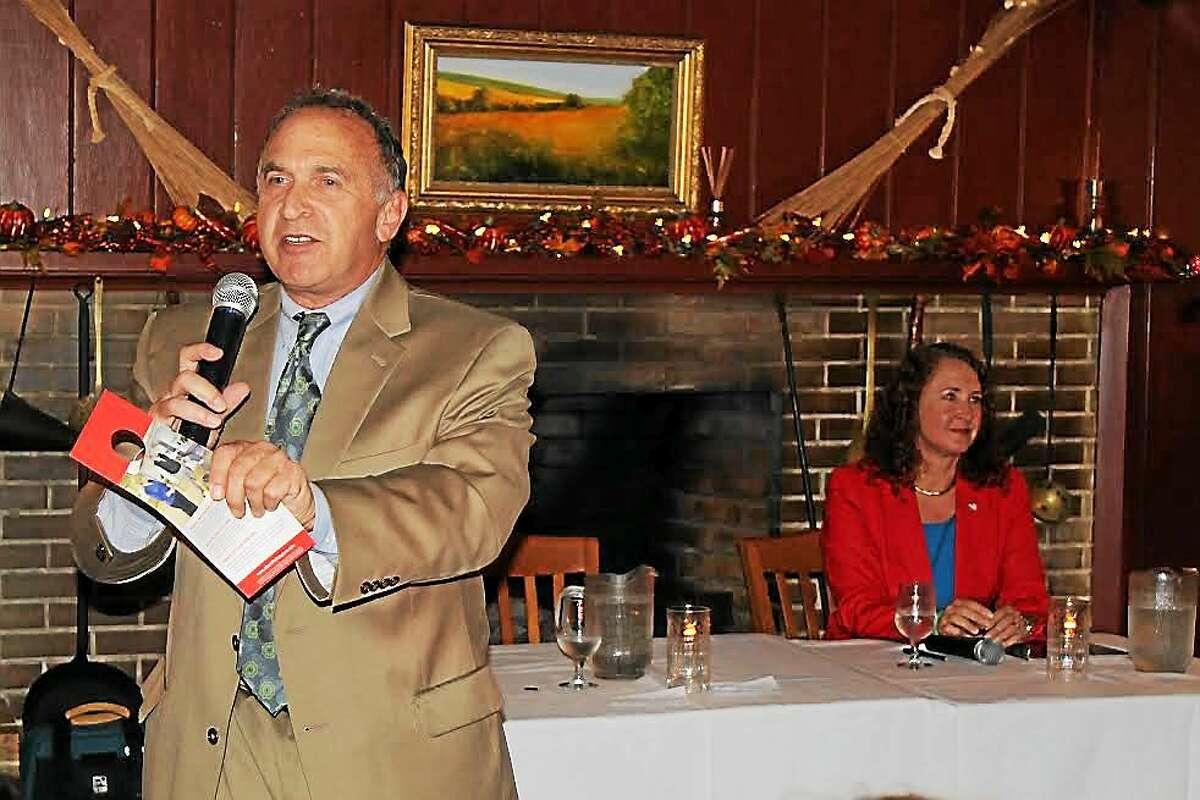 Mark Greenberg speaks at a candidatesí forum in Woodbury Tuesday night as 5th District Congresswoman Elizabeth Esty looks on.