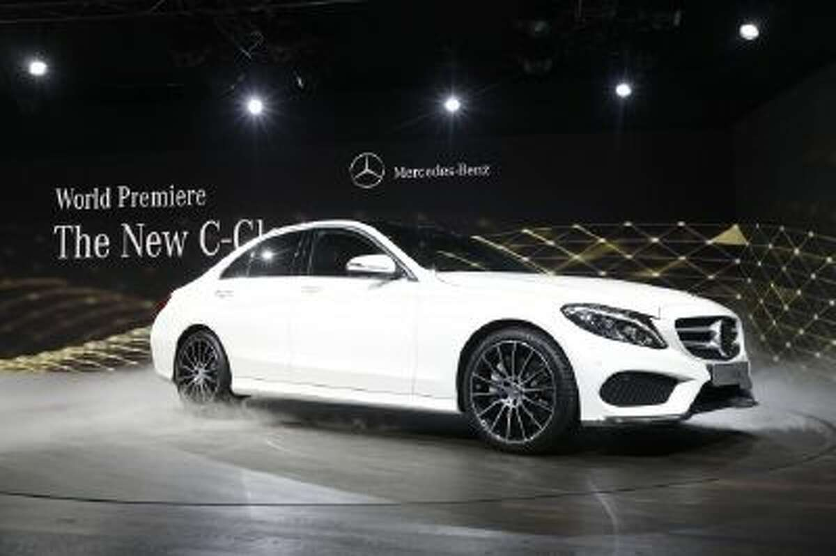 Mercedes Benz unveils the new C-Class car during a preview night for the North American International Auto Show in Detroit Jan. 12