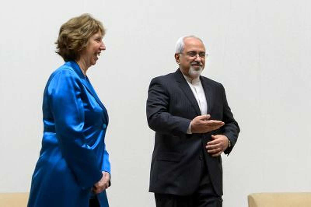 EU High Representative for Foreign Affairs Catherine Ashton, left, walks next to Iranian Foreign Minister Mohammad Javad Zarif during a photo opportunity prior to the start of two days of closed-door nuclear talks.