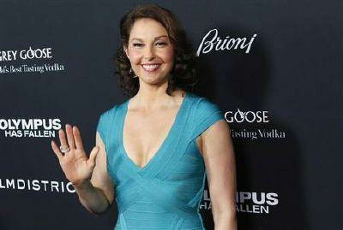 """Cast member Ashley Judd arrives at the premiere of the movie """"Olympus Has Fallen"""" at the ArcLight Cinema in Hollywood, California March 18, 2013."""