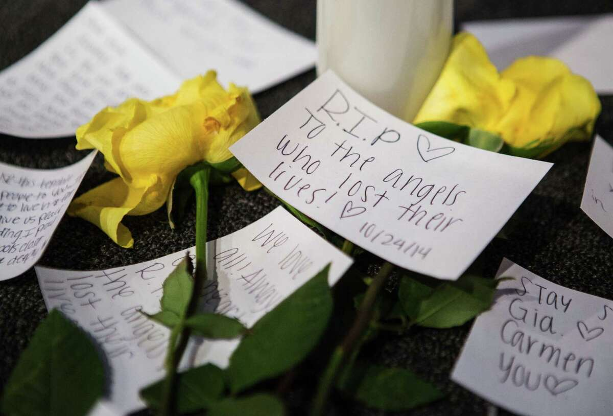 Messages of support on the stage near candles and flowers in between morning services at The Grove Church in Marysville, Wash., two days after the Marysville-Pilchuck High School shooting, on Sunday.