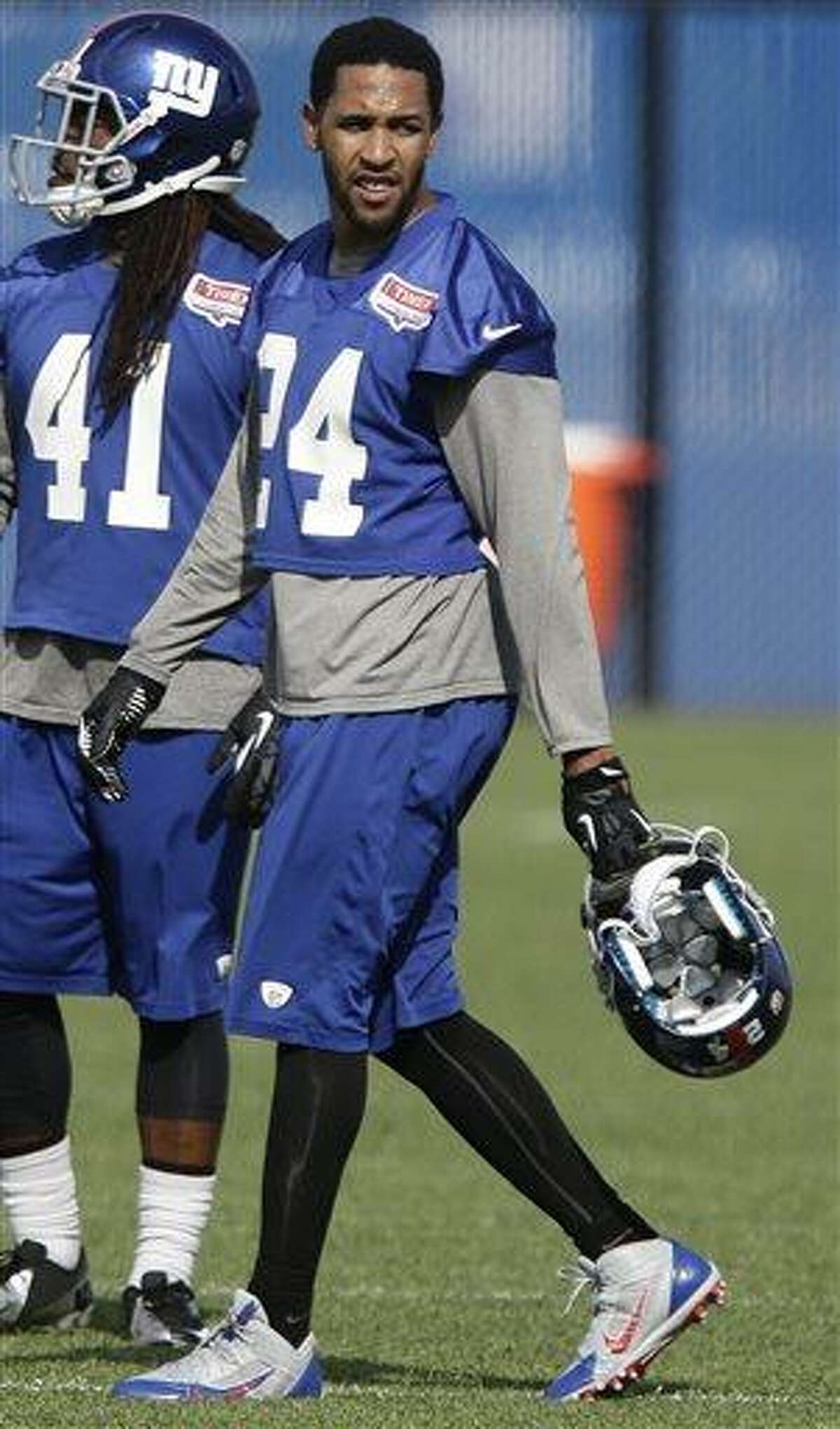 New York Giants' Terrell Thomas (24) walks on the field during mini camp Tuesday, June 11, 2013, in East Rutherford, N.J. (AP Photo/Frank Franklin II)