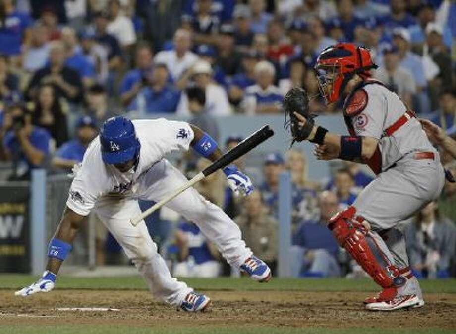 Yasiel Puig avoids a fastball high and inside thrown by St. Louis Cardinals pitcher Lance Lynn in Game 4 of the NLDS.