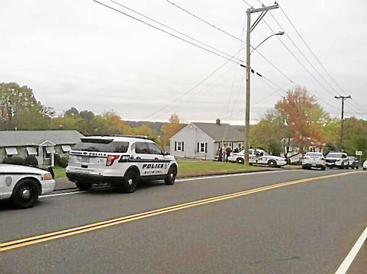 Police investigate a home invasion on Sunnyside Avenue in Watertown on Oct. 16, 2013.