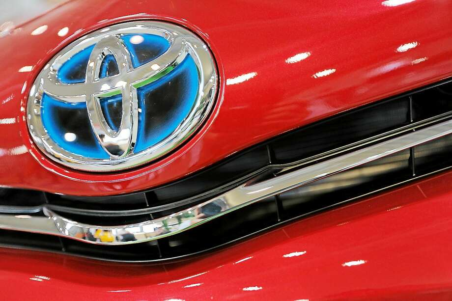 (AP Photo/Itsuo Inouye, File) Emblem of a Toyota car at Toyota Mega Web in Tokyo. Toyota continues its winning streak atop Consumer Reports' annual reliability survey, released Oct. 27, 2014. Photo: AP / AP