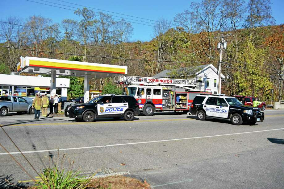 Police and fire personnel responded to the scene of a two-car crash Monday and blocked off a section of the road along Route 4 while crews accessed the damage to a gas pump that was struck in the accident. Photo: Ryan Flynn — The Register Citizen