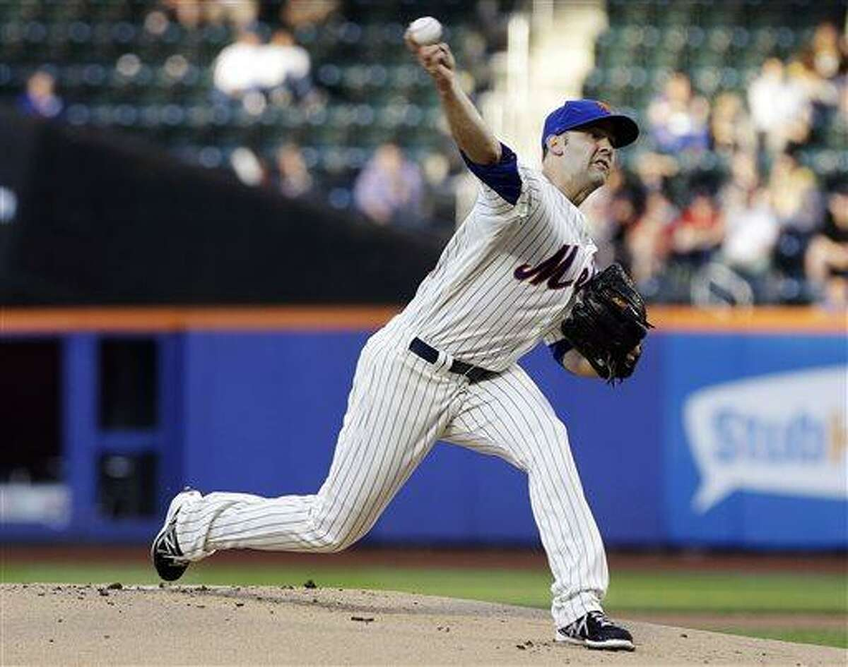 New York Mets' Dillon Gee delivers a pitch during the first inning of a baseball game against the St. Louis Cardinals Wednesday, June 12, 2013, in New York. (AP Photo/Frank Franklin II)