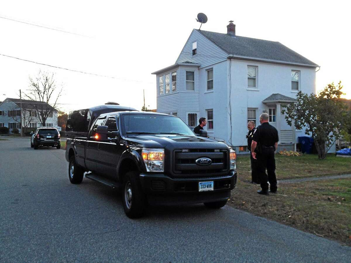 A Connecticut State Police bomb technician vehicle is seen parked in front of a home on Oak Avenue Monday in Torrington. Police were called on the scene after receiving a report of a possible grenade device found inside.