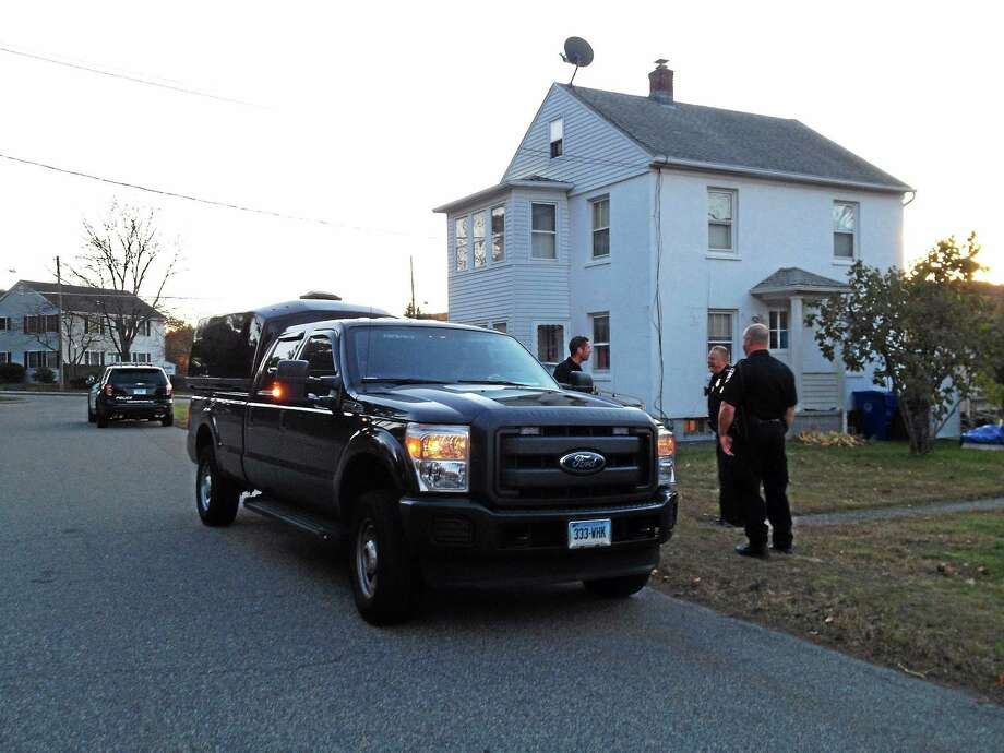 A Connecticut State Police bomb technician vehicle is seen parked in front of a home on Oak Avenue Monday in Torrington. Police were called on the scene after receiving a report of a possible grenade device found inside. Photo: Esteban L. Hernandez — The Register Citizen