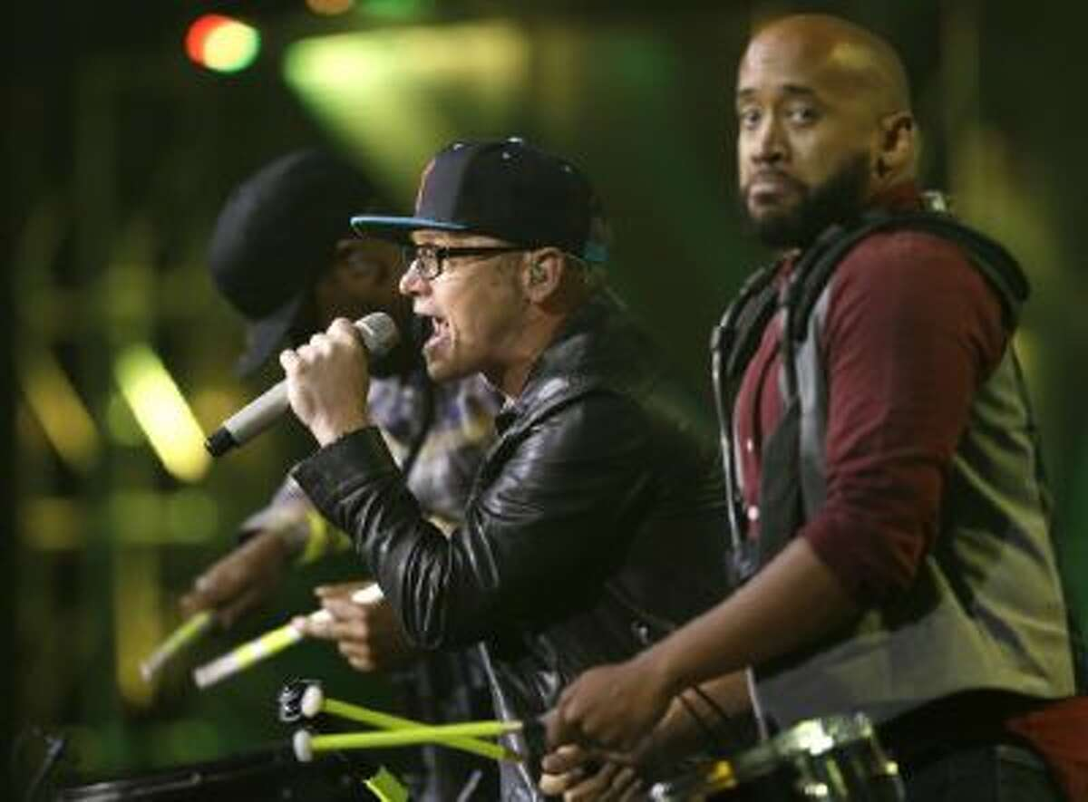 TobyMac, center, performs at the Dove Awards on Tuesday, Oct. 15, 2013, in Nashville, Tenn.