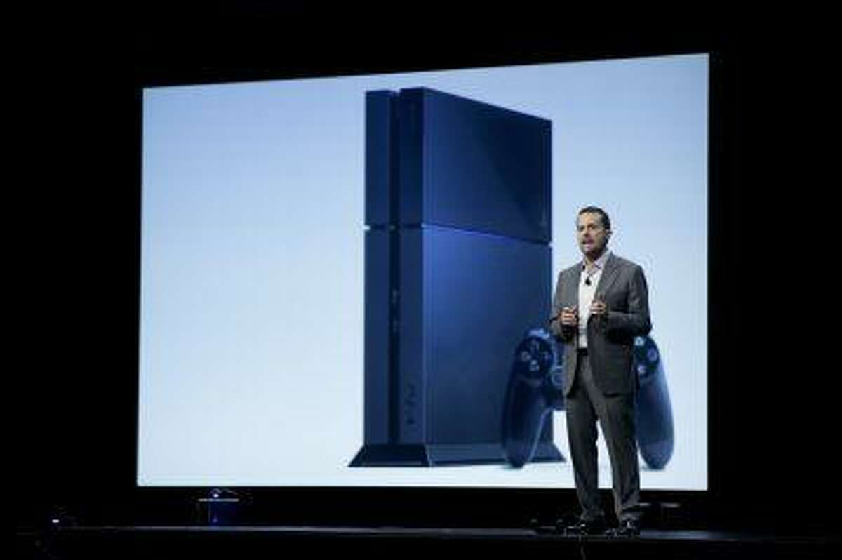 Sony Computer Entertainment president and CEO Andrew House stands in front of an images of the new PlayStation 4 at the E3 conference in Los Angeles, Monday, June 10, 2013.