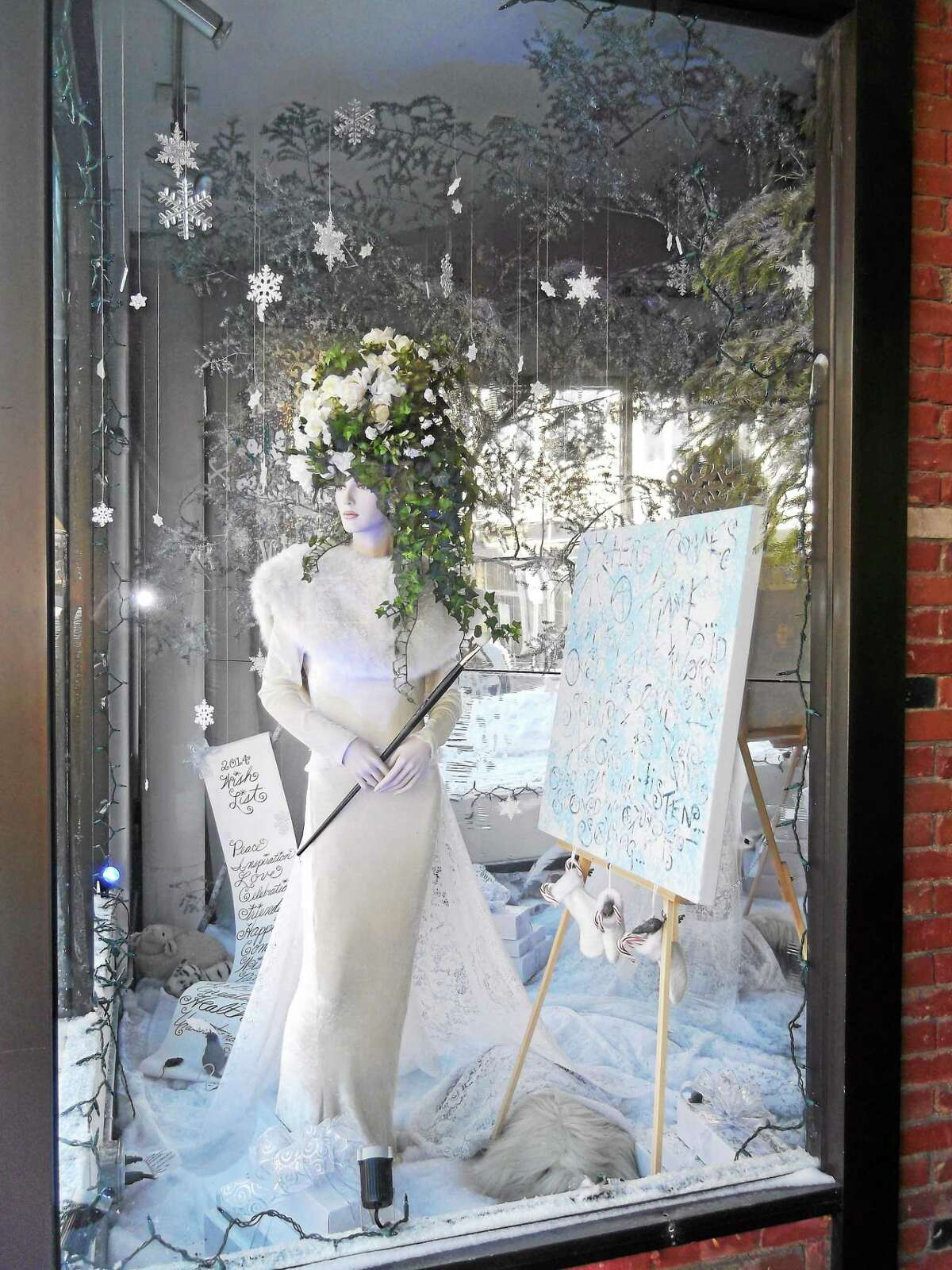 The window display created by CAFTA students Leslie Tapia Bernal, Corina Wallenta, Kate Lewton, and Tim O'Connell. In the window display there is a secret message, the first person to figure it out and submit it to CAFTA wins $50.