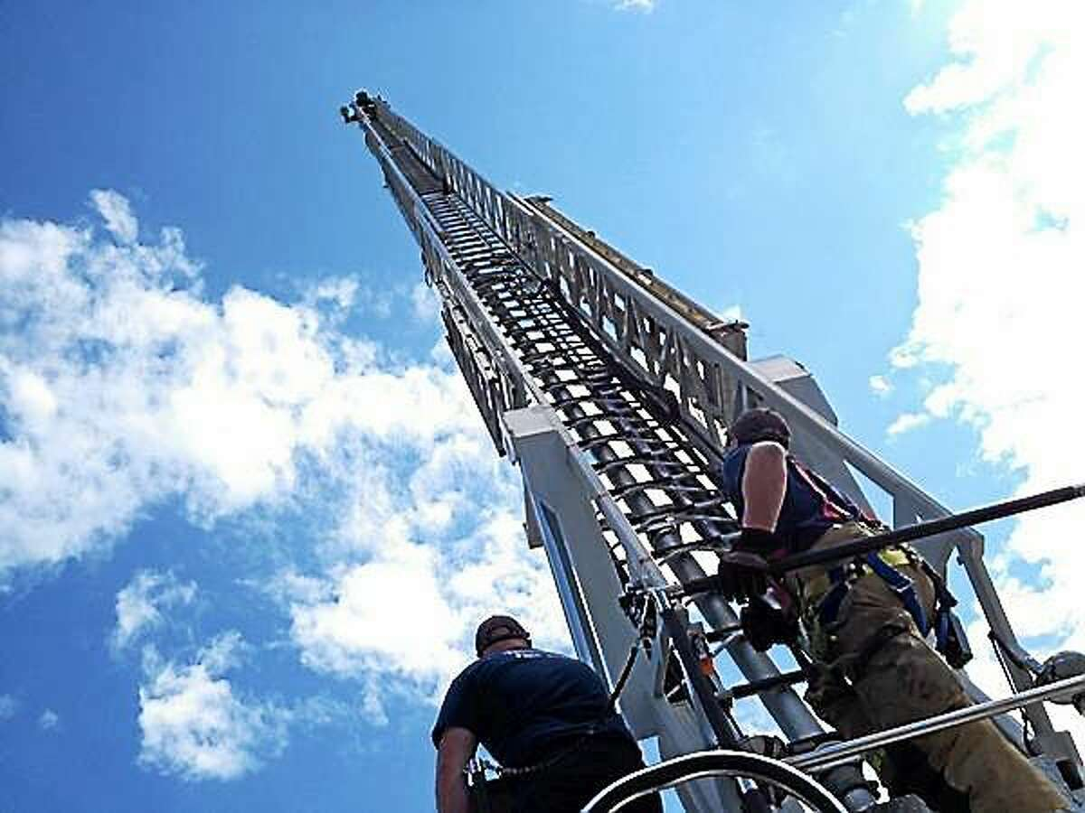 Torrington firefighters train aboard a 100-foot ladder truck during a drill in August.