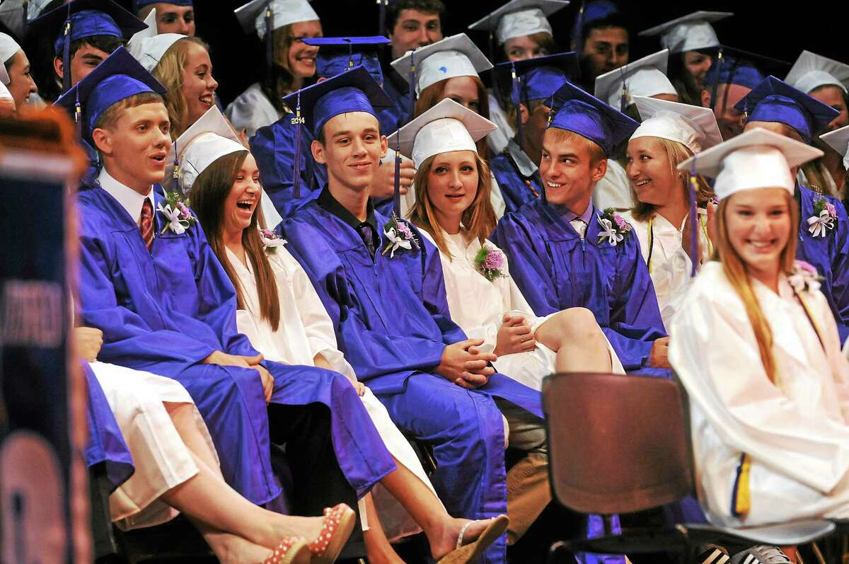 Members of the Litchfield High School Class of 2014 react during their commencement ceremony at the Warner Theatre in Torrington in June.