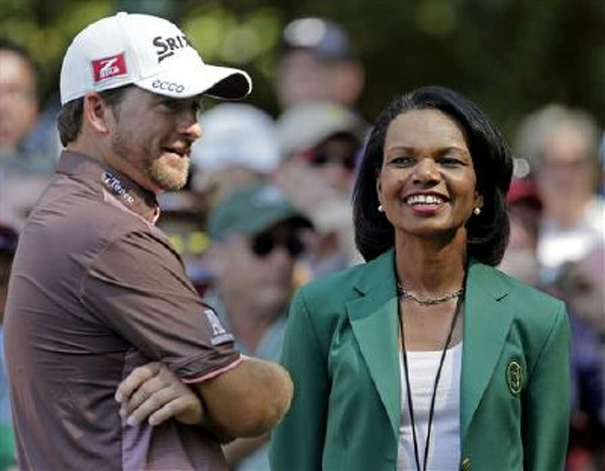 Former Secretary of State Condoleezza Rice, right, speaks with Graeme McDowell, of Northern Ireland, during the Masters golf tournament in Augusta, Ga.