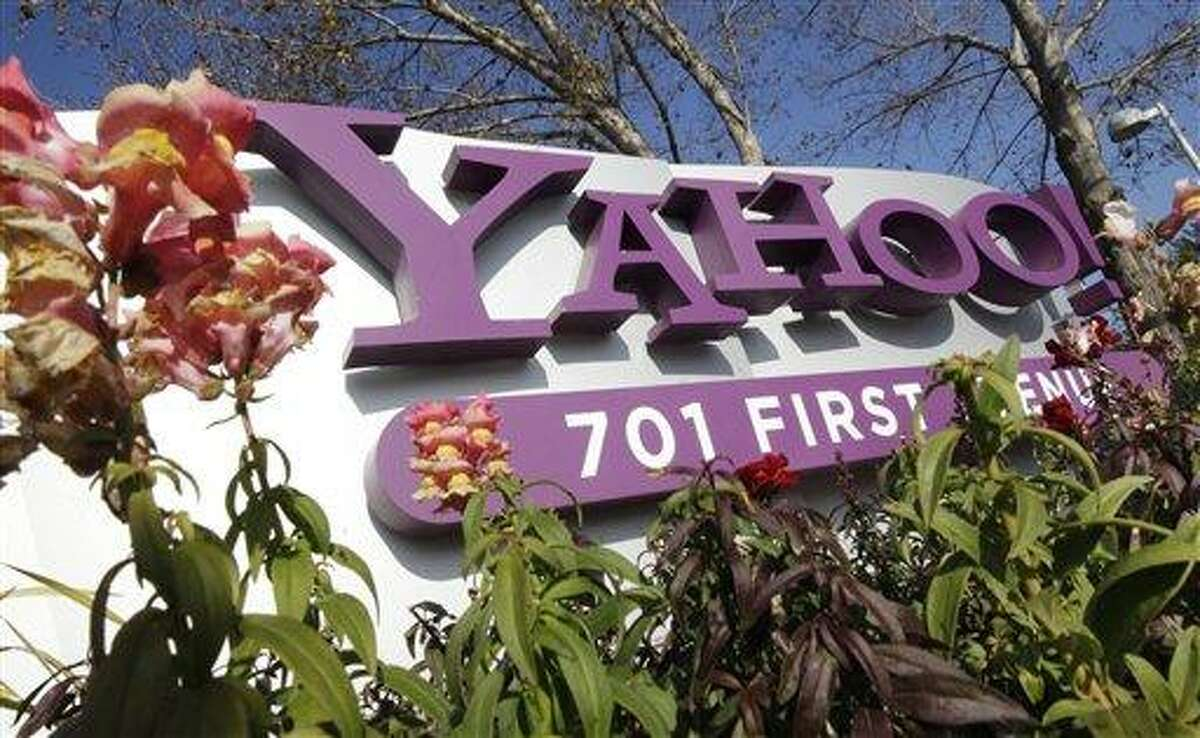 The company logo is displayed at Yahoo headquarters in Sunnyvale, Calif. One of Britain's youngest Internet entrepreneurs has hit the jackpot after selling his top-selling mobile application Summly to search giant Yahoo the company announced Monday March 25, 2012. AP Photo/Paul Sakuma