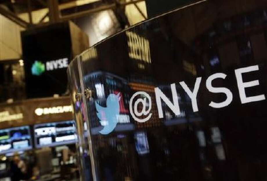 The Twitter bird logo is on an updated phone post on the floor of the New York Stock Exchange, Wednesday Nov. 6, 2013. Photo: AP / AP