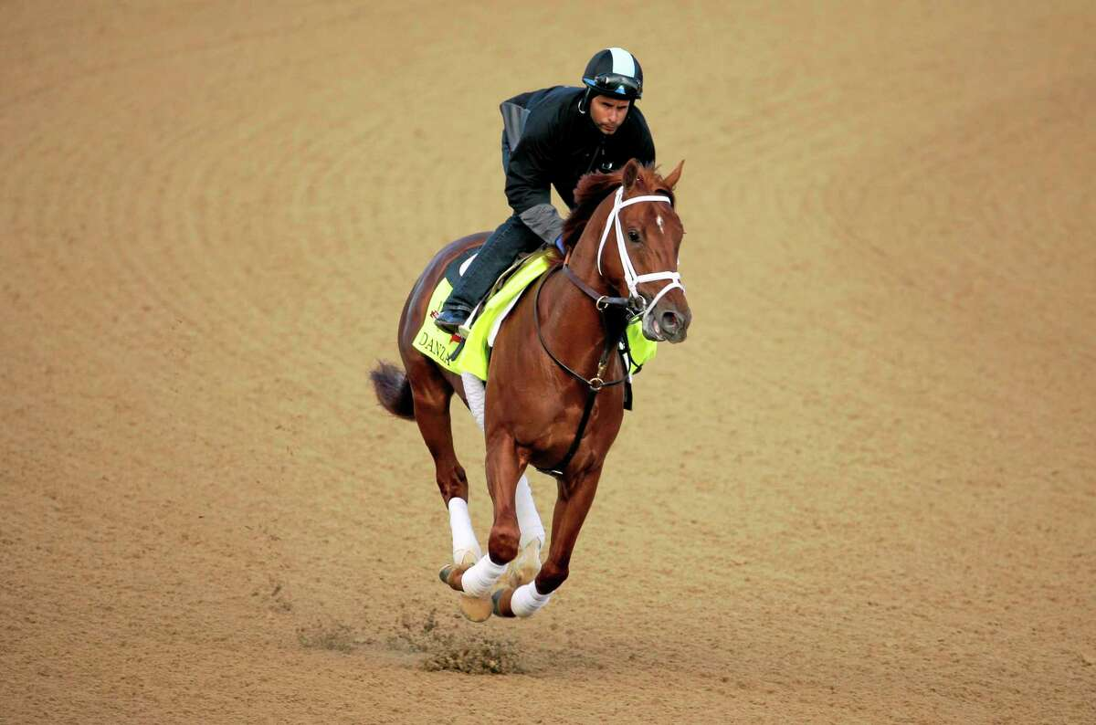 Exercise rider Ezequiel Perez takes Kentucky Derby entrant Danza for a morning workout Thursday at Churchill Downs in Louisville, Ky.