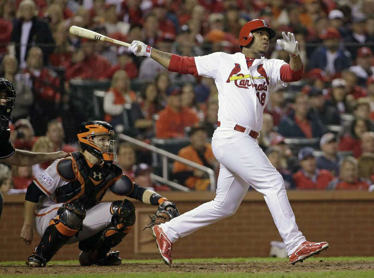 This Oct. 12, 2014 file photo shows St. Louis Cardinals' Oscar Taveras hitting a home run during the seventh inning of Game 2 of the NLCS against the Giants.