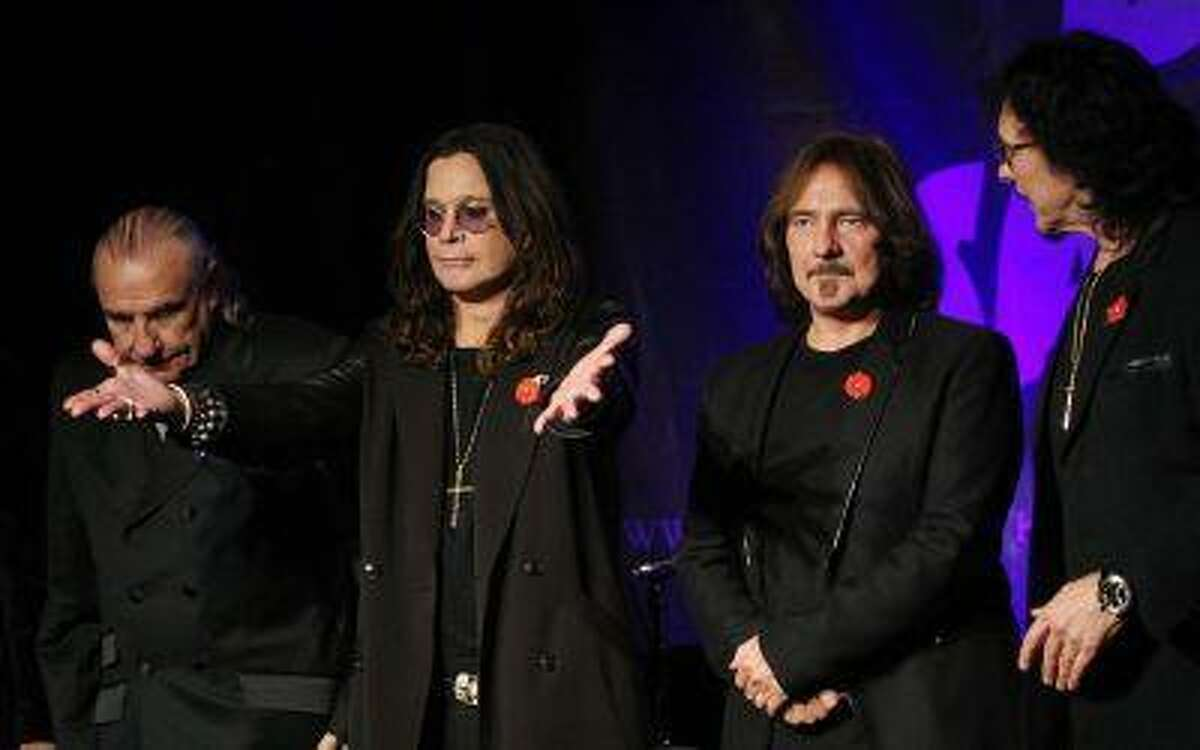 Original members of the rock band Black Sabbath (L-R), Bill Ward, Ozzy Osborne, Geezer Butler and Tony Lommi, announce the reunion of the rock group at the Whiskey A Go Go, the club where the band first performed 41 years ago, at 11:11 a.m. on 11/11/11 in Los Angeles, Calif.November 11, 2011. (REUTERS/David McNew)
