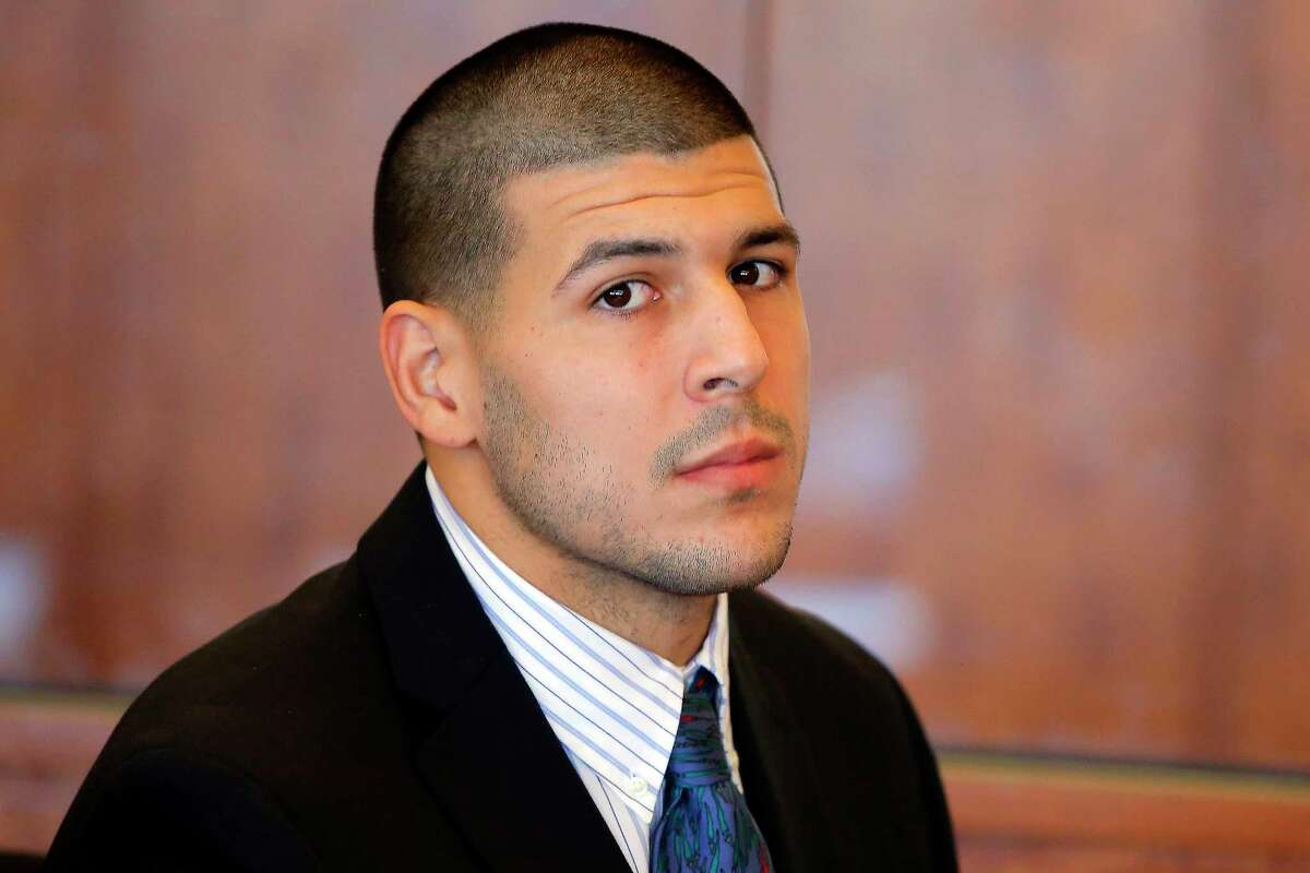 In this Oct. 9, 2013, file photo, former New England Patriots NFL football player Aaron Hernandez attends a pre-trial court hearing in Fall River, Mass.