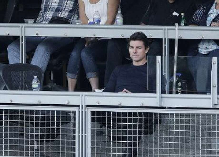 Tom Cruise watches Game 4 of the 2013 NLCS in Los Angeles.