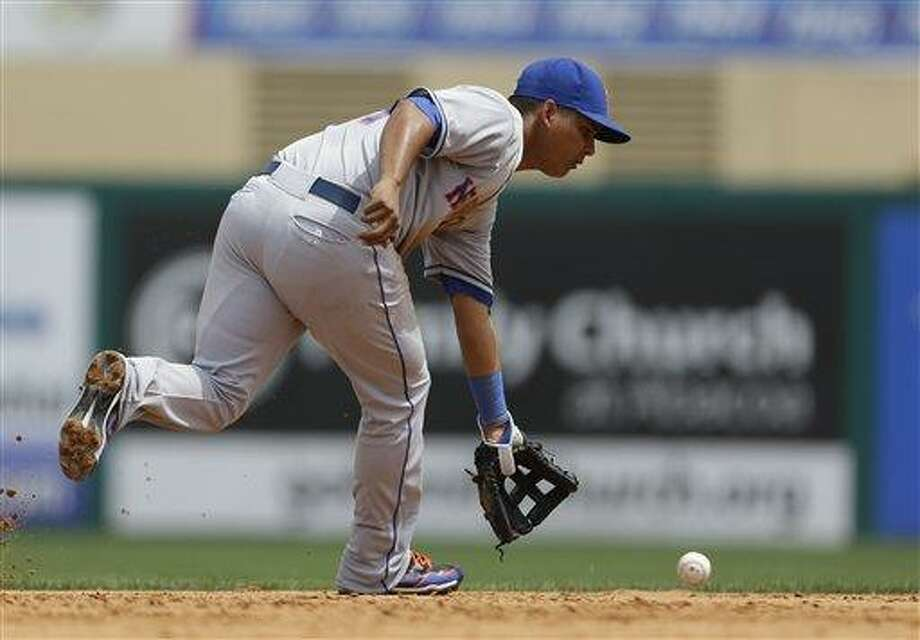 New York Mets shortstop Ruben Tejada handles a grounder during the fifth inning of an exhibition spring training baseball game against the St. Louis Cardinals Monday, March 18, 2013, in Jupiter, Fla. The Mets won 3-2. (AP Photo/Jeff Roberson) Photo: ASSOCIATED PRESS / AP2013