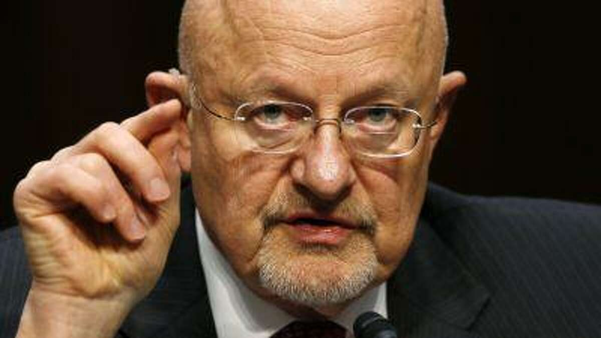 """Director of National Intelligence James Clapper testifies before a Senate Intelligence Committee hearing on """"Current and Projected National Security Threats to the United States"""" on Capitol Hill in Washington, D.C., March 12, 2013."""