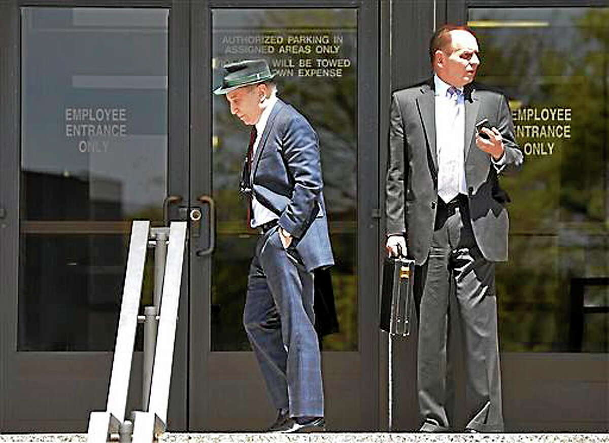 Singer Paul Simon, left, leaves Norwalk Superior Court with his attorney Stephen Hayes after a hearing Monday April 28, 2014 in Norwalk, Conn. Simon and his wife Edie Brickell were arrested Saturday on disorderly conduct charges by officers investigating a family dispute at their home in New Canaan. (AP Photo/The Hour, Alex von Kleydorff)