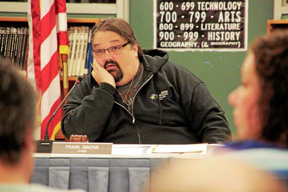 Shako Liu — The Register Citizen Chair of the education board Frank Simone listened to public comments during a meeting Wednesday.